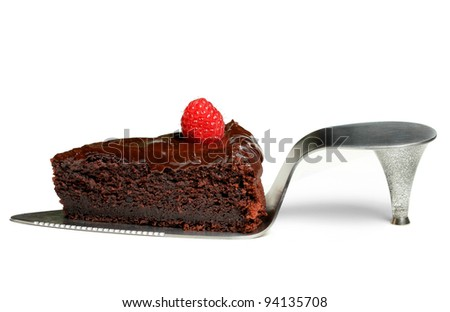 a slice of chocolate cake with raspberry on shoe cake server isolated - stock photo