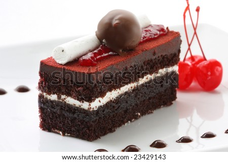 A slice of delicious black forest cake, garnished with all the goodies - stock photo