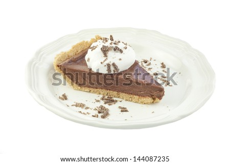 A slice of delicious chocolate cream pie topped with whipped cream and chocolate shavings, isolate on white background - stock photo