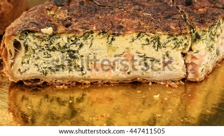 A slice of fresh baked salmon quiche at farm market. - stock photo