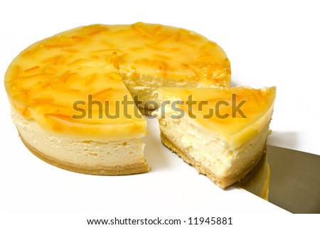 A slice of lemon cheesecake being cut - stock photo