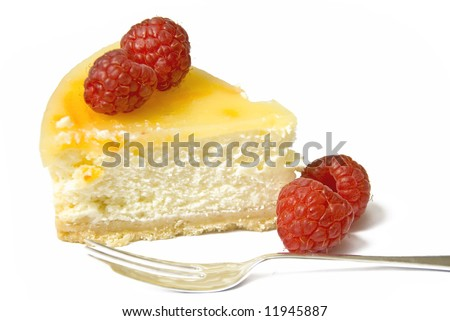 A slice of lemon cheesecake with raspberries and a fork - stock photo