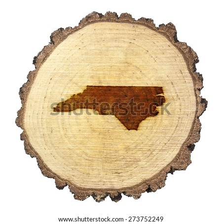 A slice of oak and the shape of North Carolina branded onto .(series) - stock photo