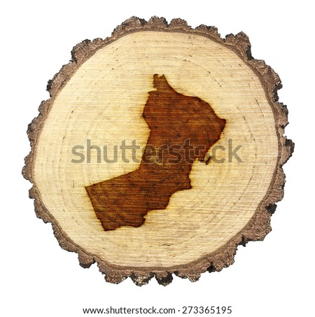A slice of oak and the shape of Oman branded onto .(series) - stock photo