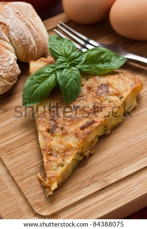 A slice of omelette an potatoes - stock photo