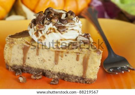 A slice of pumpkin cheesecake - stock photo