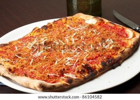 a slice of sicilian traditional pizza sfincione - stock photo