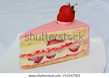 A slice of strawberry cake  - stock photo