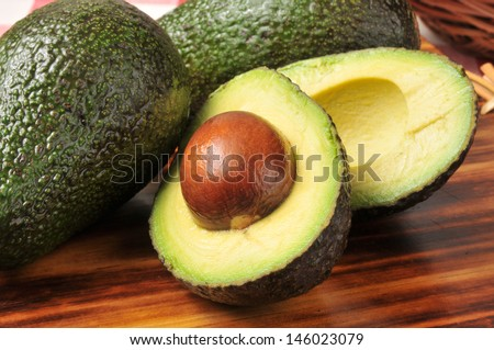 A sliced avocado on a cutting board - stock photo