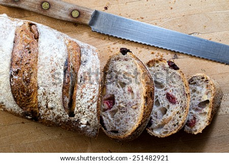 A sliced loaf of cranberry walnut bread - stock photo
