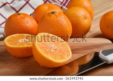A sliced orange closeup on a cutting board