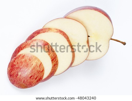 A sliced red apple isolated on white background.