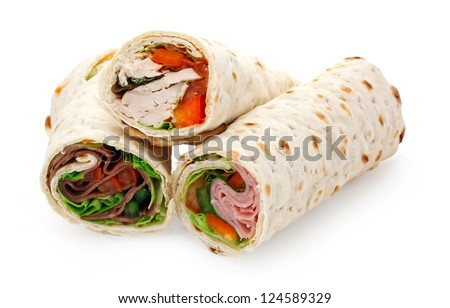 A sliced tortilla wrap a rollup of flatbread with assorted fillings