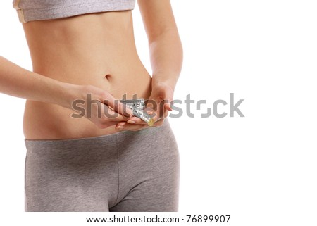 A slim girl holding a measuring tape - stock photo
