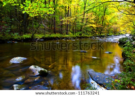 A slow moving stream in the Smoky Mountains in fall - stock photo