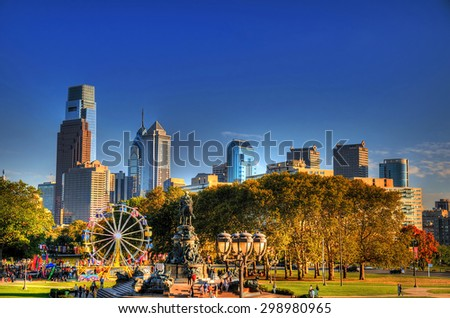 A small amusement park with the background of the skyline of philadelphia in high dynamic range (HDR) - stock photo