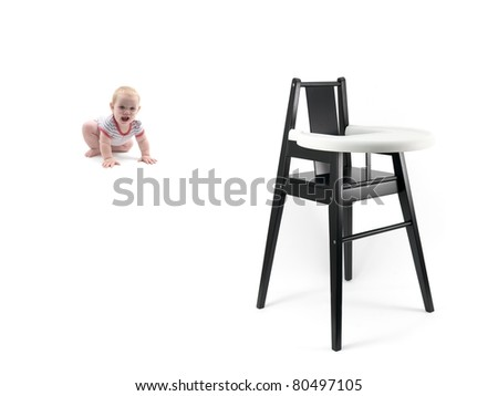 A small baby girl and a high chair