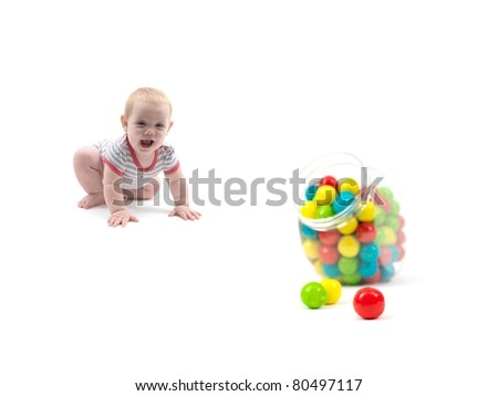 A small baby girl with gum balls