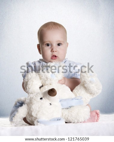 a small baby with her teddy bear - stock photo
