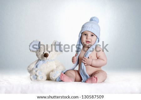 a small baby with his favorite teddy - stock photo