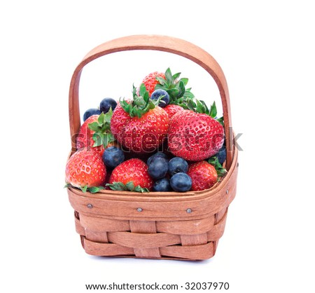 A small basket of fresh strawberries and blue berries.