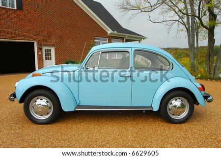A small blue antique car. - stock photo