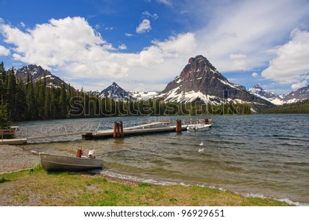 A small boat by Two Medicine Lake in Glacier National Park