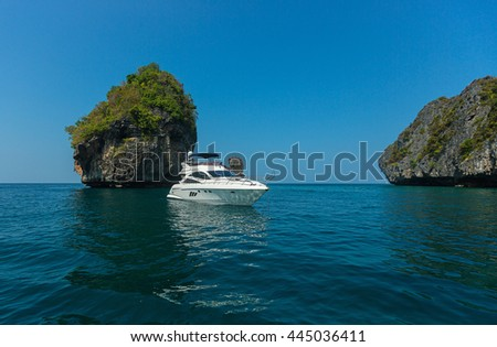 A small boat in the sea on the background of the island. Thailand. Phuket.