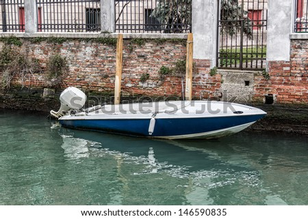 A small boat in Venice. Italy - stock photo