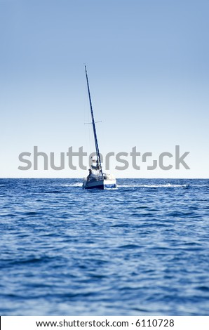 A small boat sailing on a sunny morning - stock photo