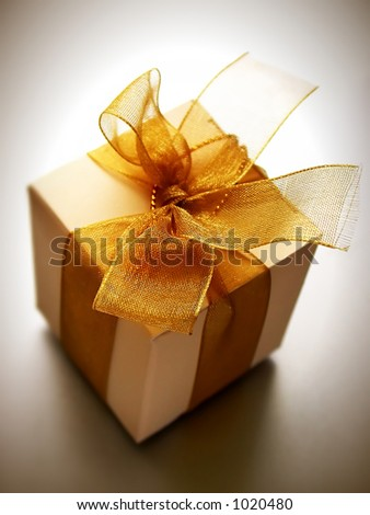 A small box of appreciation gift. Shallow depth of field shot is intentional. - stock photo
