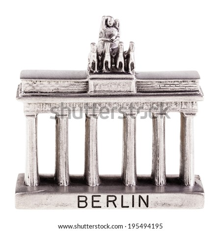 a small brandenburg gate reproduction isolated over a white background - stock photo