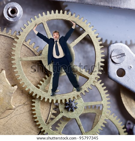 A small but reliable part of the enterprise - worker inside cogwheel - stock photo