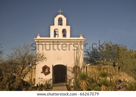 "A small chapel within the historic San Xavier del Bac Mission outside of Tucson, Arizona, also known as the ""Dove of the Desert"". - stock photo"