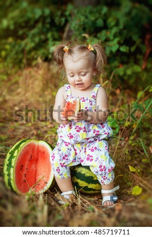 A small child eating watermelon. The concept of lifestyle and healthy food.