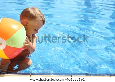 a small child in the pool - stock photo