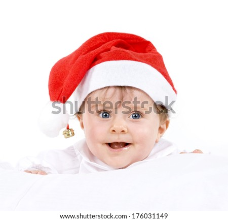 A small child wearing a Santa Claus hat.