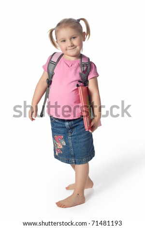 a small child with a book - stock photo