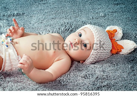A small child with a rabbit ears. - stock photo