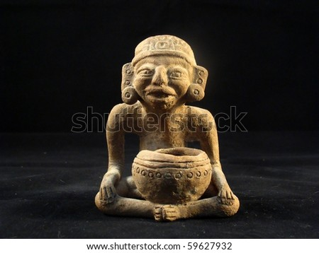 A small clay Maya shaman figure - stock photo