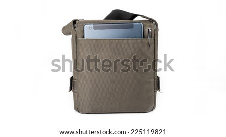 A small dark green sling bag with a tablet device and pen. Isolated on white background.