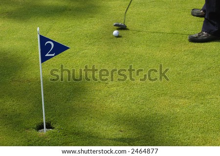 a small detail of a man playing golf - stock photo