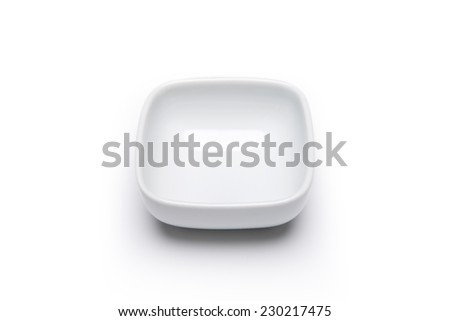 A small dish(plate) for soy isolated white at the studio. - stock photo