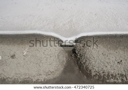a small ditch was blocked by a small piece of plate between salt and soil.