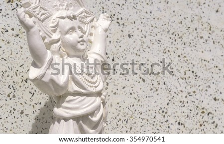 a small doll in a cemetery
