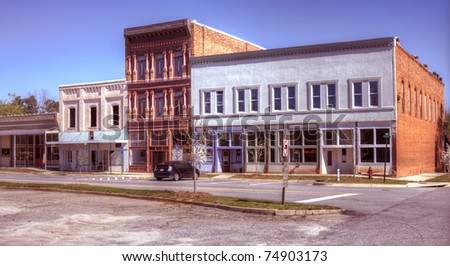 A small downtown area in Northeast, Georgia with old film effect. - stock photo