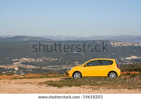 a small family yellow car - stock photo