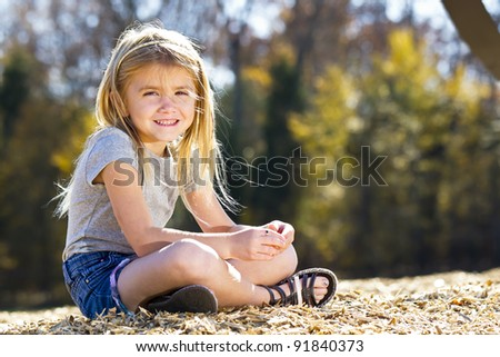 A small female child enjoying a day at the park - stock photo