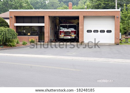 A small fire house with two garage bays.