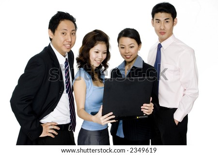 A small group of four young asian businessmen and women on white background